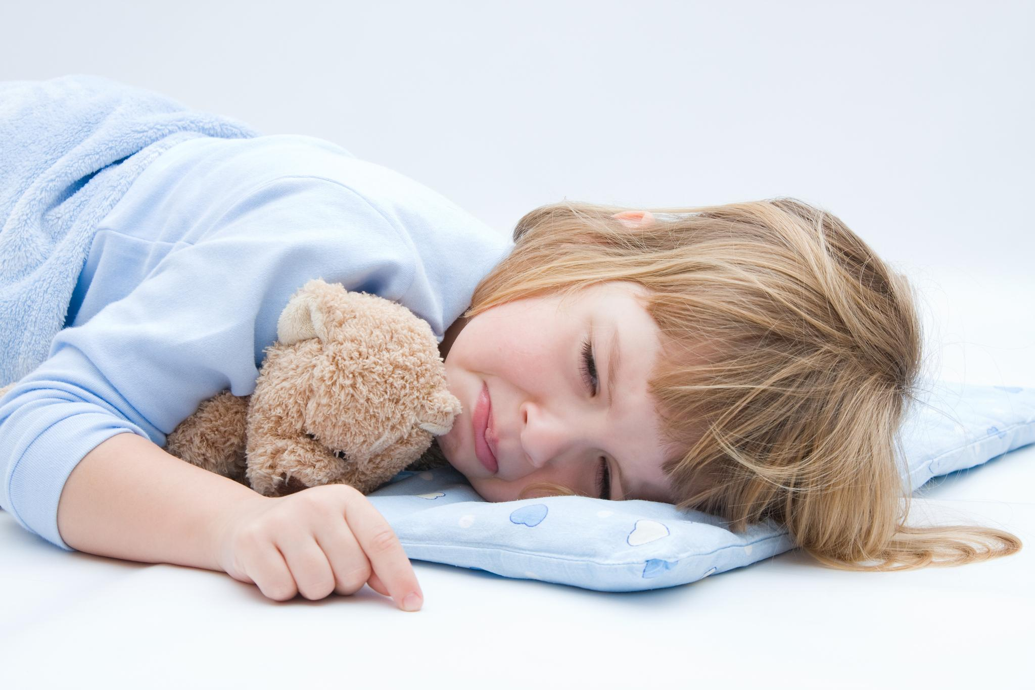 child with teddy bear, sleeping and crying